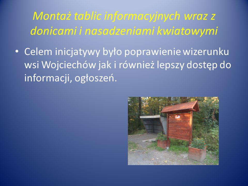 Montaż tablic informacyjnych wraz z donicami i nasadzeniami kwiatowymi Celem inicjatywy było poprawienie wizerunku wsi Wojciechów jak i również lepszy