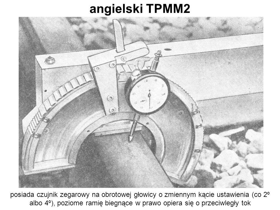 angielski TPMM2 posiada czujnik zegarowy na obrotowej głowicy o zmiennym kącie ustawienia (co 2º albo 4º), poziome ramię biegnące w prawo opiera się o