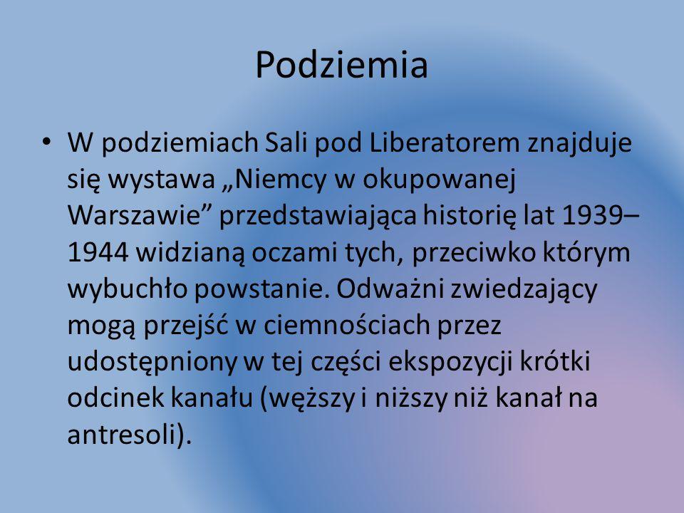 """Podziemia W podziemiach Sali pod Liberatorem znajduje się wystawa """"Niemcy w okupowanej Warszawie przedstawiająca historię lat 1939– 1944 widzianą oczami tych, przeciwko którym wybuchło powstanie."""