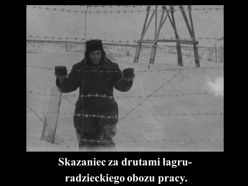 Skazaniec za drutami łagru- radzieckiego obozu pracy.