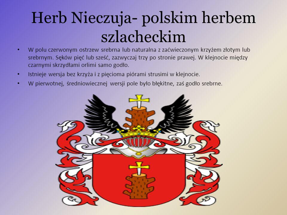 Herb Nieczuja- polskim herbem szlacheckim W polu czerwonym ostrzew srebrna lub naturalna z zaćwieczonym krzyżem złotym lub srebrnym. Sęków pięć lub sz