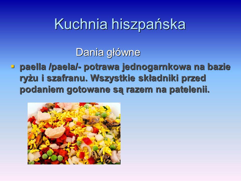 Kuchnia hiszpańska Dania główne Dania główne  paella /paela/- potrawa jednogarnkowa na bazie ryżu i szafranu. Wszystkie składniki przed podaniem goto