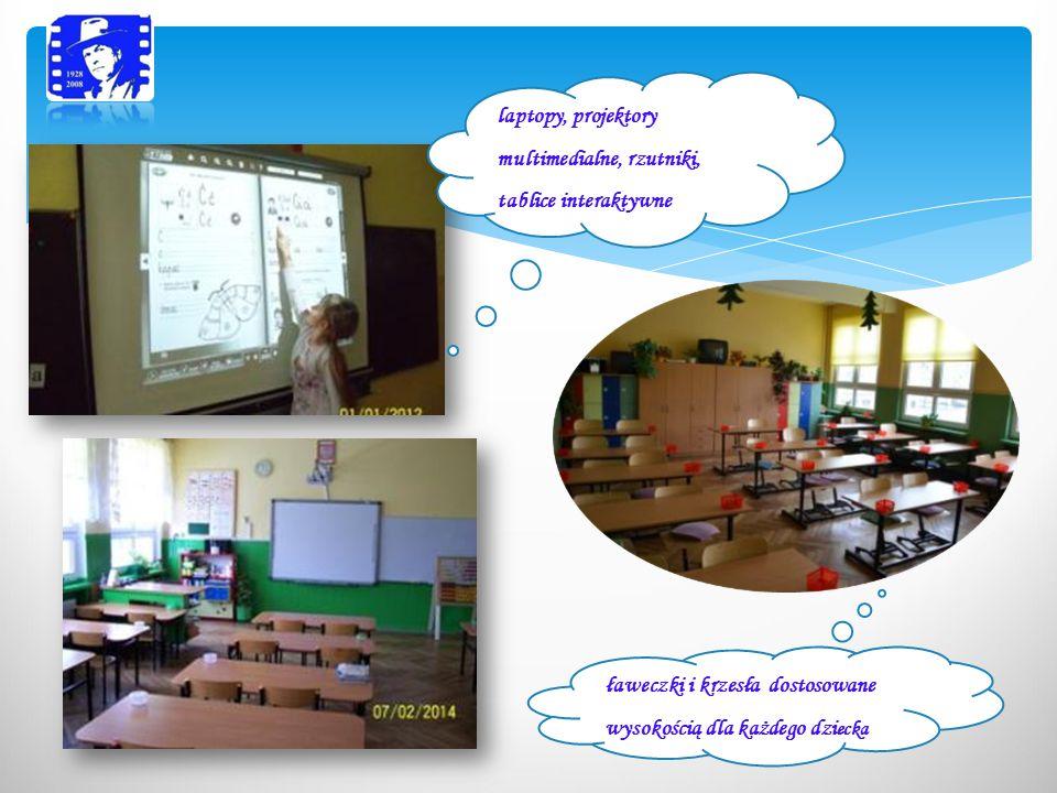 laptopy, projektory multimedialne, rzutniki, tablice interaktywne ławeczki i krzesła dostosowane wysokością dla każdego dzi ecka