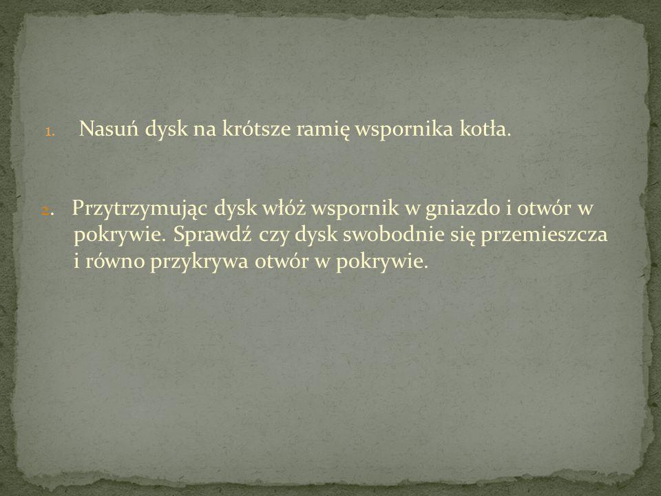 1. Nasuń dysk na krótsze ramię wspornika kotła. 2.