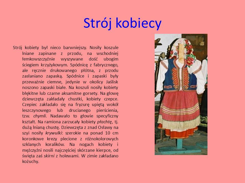 Strój kobiecy Strój kobiety był nieco barwniejszy. Nosiły koszule lniane zapinane z przodu, na wschodniej łemkowszczyźnie wyszywane dość ubogim ściegi