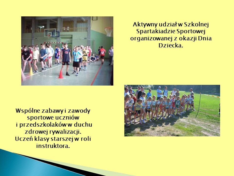 Aktywny udział w Szkolnej Spartakiadzie Sportowej organizowanej z okazji Dnia Dziecka. Wspólne zabawy i zawody sportowe uczniów i przedszkolaków w duc