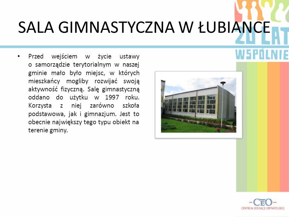 SALA GIMNASTYCZNA W ŁUBIANCE Przed wejściem w życie ustawy o samorządzie terytorialnym w naszej gminie mało było miejsc, w których mieszkańcy mogliby rozwijać swoją aktywność fizyczną.