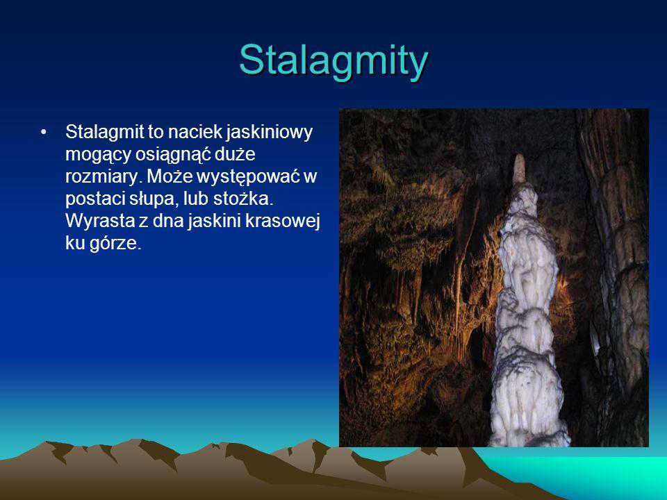 Stalaktyty Stalaktyt to naciek jaskiniowy, który wyrasta z sufitu jaskini krasowej.