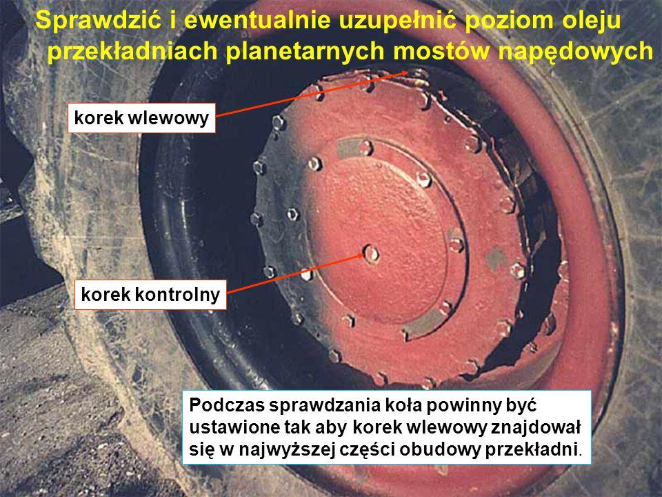 Sprawdzić i ewentualnie uzupełnić poziom oleju przekładniach planetarnych mostów napędowych korek kontrolny korek wlewowy Podczas sprawdzania koła powinny być ustawione tak aby korek wlewowy znajdował się w najwyższej części obudowy przekładni.