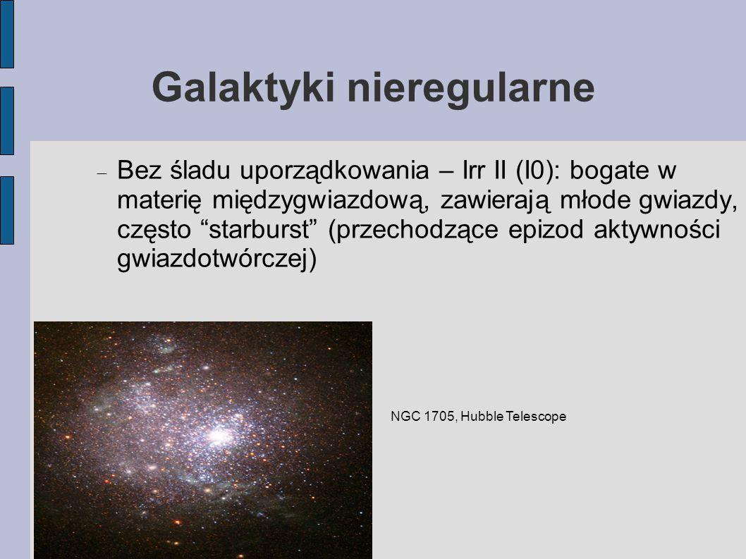 Galaktyki nieregularne  Bez śladu uporządkowania – Irr II (I0): bogate w materię międzygwiazdową, zawierają młode gwiazdy, często starburst (przechodzące epizod aktywności gwiazdotwórczej) NGC 1705, Hubble Telescope