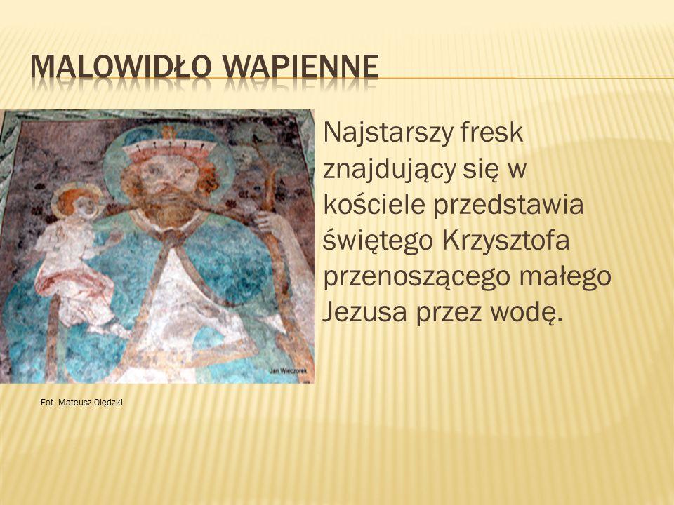 Najstarszy fresk znajdujący się w kościele przedstawia świętego Krzysztofa przenoszącego małego Jezusa przez wodę. Fot. Mateusz Olędzki