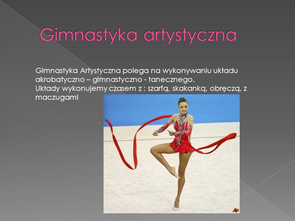 Gimnastyka Artystyczna polega na wykonywaniu układu akrobatyczno – gimnastyczno - tanecznego. Układy wykonujemy czasem z : szarfą, skakanką, obręczą,