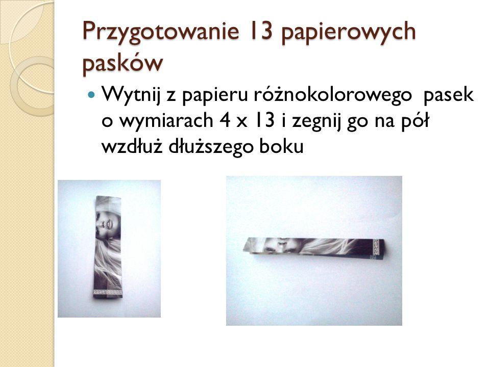 Przygotowanie 13 papierowych pasków Wytnij z papieru różnokolorowego pasek o wymiarach 4 x 13 i zegnij go na pół wzdłuż dłuższego boku