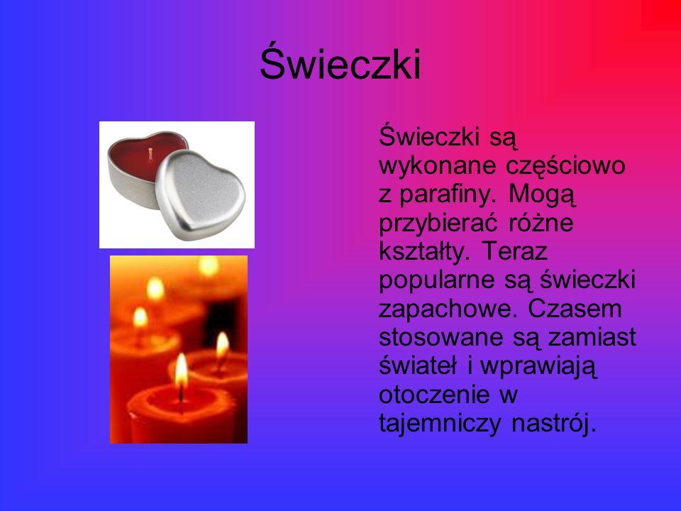 Świeczki Świeczki są wykonane częściowo z parafiny. Mogą przybierać różne kształty. Teraz popularne są świeczki zapachowe. Czasem stosowane są zamiast