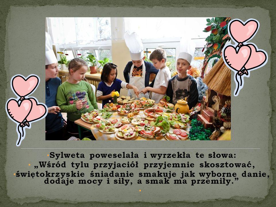 """Sylweta poweselała i wyrzekła te słowa: """"Wśród tylu przyjaciół przyjemnie skosztować, świętokrzyskie śniadanie smakuje jak wyborne danie, dodaje mocy i siły, a smak ma przemiły."""