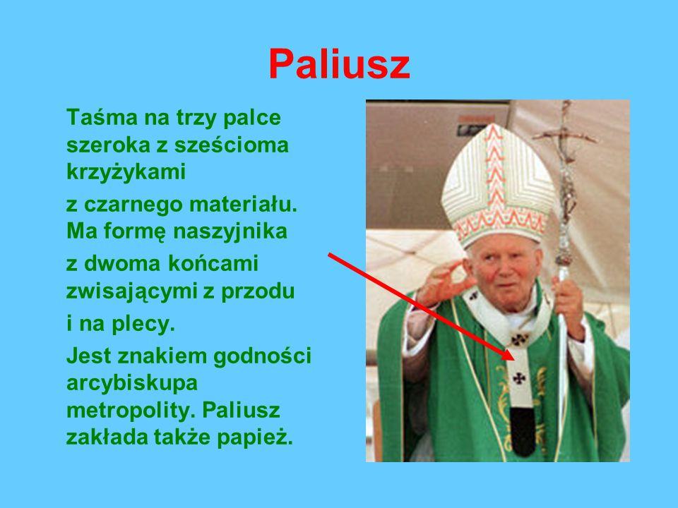 Paliusz Taśma na trzy palce szeroka z sześcioma krzyżykami z czarnego materiału.
