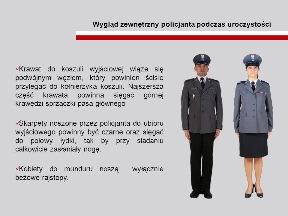 Wygląd zewnętrzny policjanta podczas uroczystości Krawat do koszuli wyjściowej wiąże się podwójnym węzłem, który powinien ściśle przylegać do kołnierz