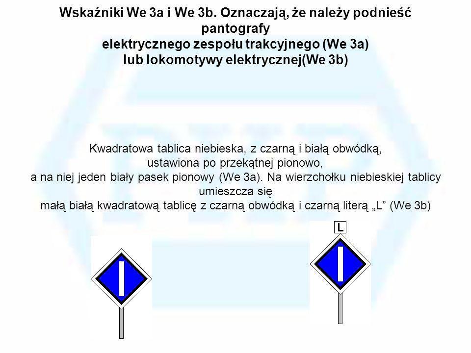 Wskaźniki We 3a i We 3b. Oznaczają, że należy podnieść pantografy elektrycznego zespołu trakcyjnego (We 3a) lub lokomotywy elektrycznej(We 3b) Kwadrat
