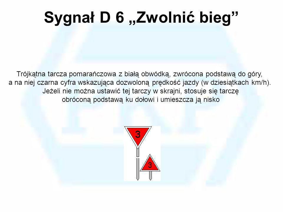 Sygnał D 6 Zwolnić bieg Trójkątna tarcza pomarańczowa z białą obwódką, zwrócona podstawą do góry, a na niej czarna cyfra wskazująca dozwoloną prędkość