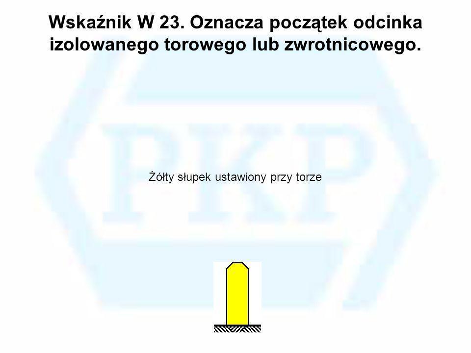 Wskaźnik W 23. Oznacza początek odcinka izolowanego torowego lub zwrotnicowego. Żółty słupek ustawiony przy torze