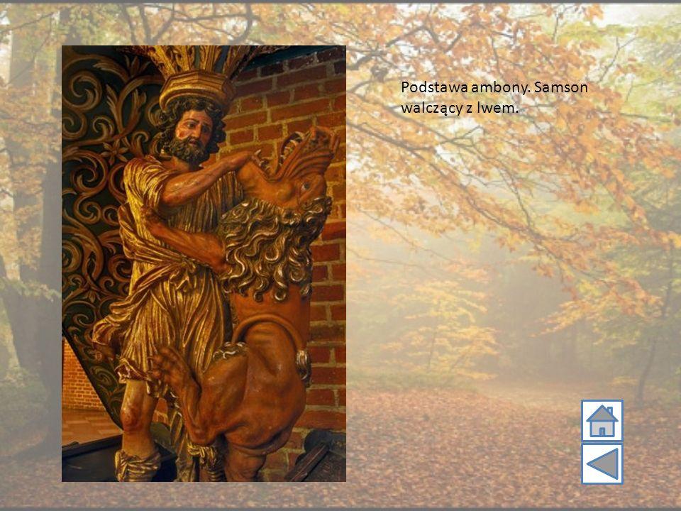 Podstawa ambony. Samson walczący z lwem.