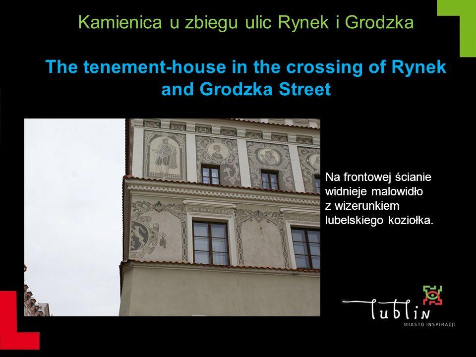 Kamienica u zbiegu ulic Rynek i Grodzka The tenement-house in the crossing of Rynek and Grodzka Street Na frontowej ścianie widnieje malowidło z wizer