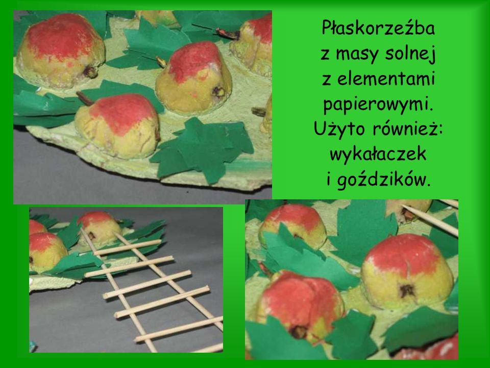 Płaskorzeźba z masy solnej z elementami papierowymi. Użyto również: wykałaczek i goździków.