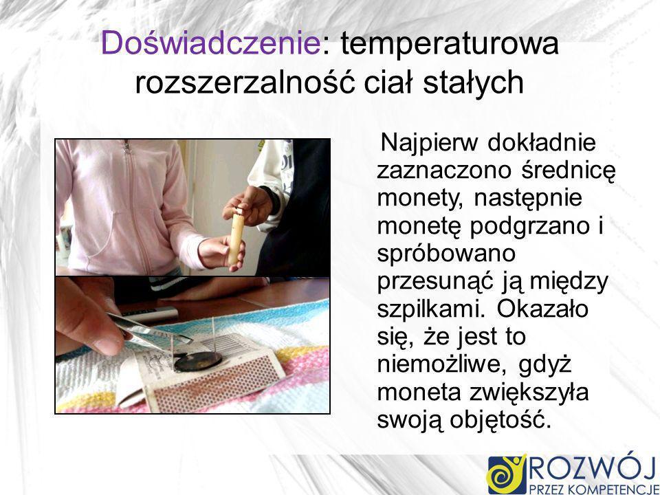 Doświadczenie: temperaturowa rozszerzalność ciał stałych Najpierw dokładnie zaznaczono średnicę monety, następnie monetę podgrzano i spróbowano przesu