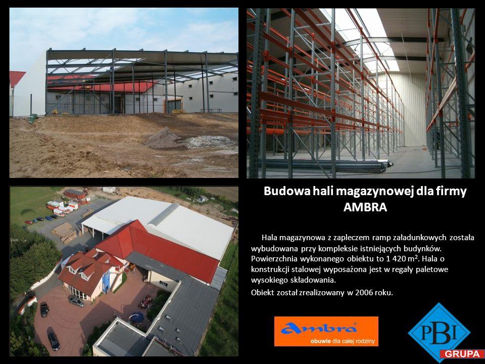 Budowa hali magazynowej dla firmy AMBRA Hala magazynowa z zapleczem ramp załadunkowych została wybudowana przy kompleksie istniejących budynków. Powie