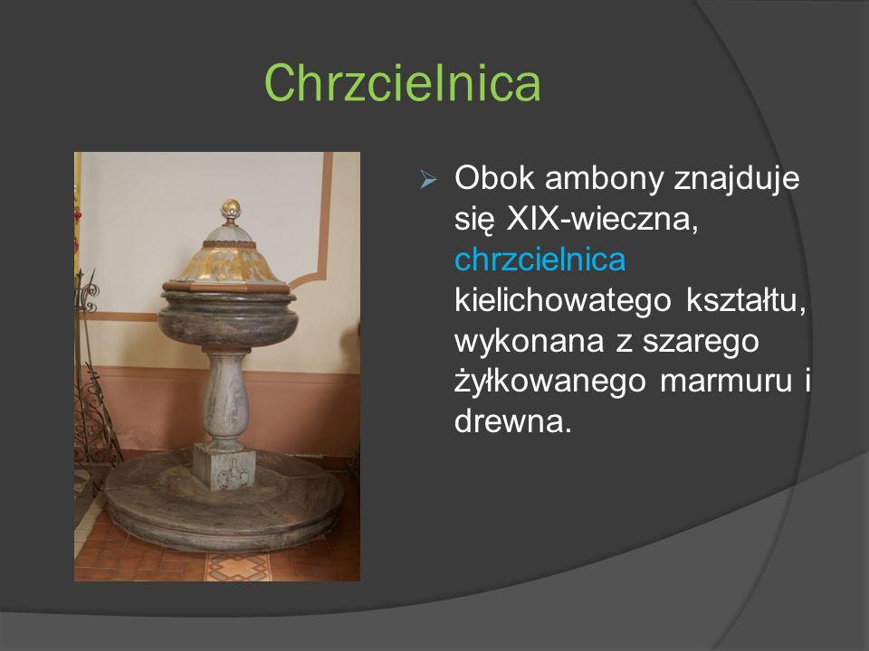 Chrzcielnica Obok ambony znajduje się XIX-wieczna, chrzcielnica kielichowatego kształtu, wykonana z szarego żyłkowanego marmuru i drewna.