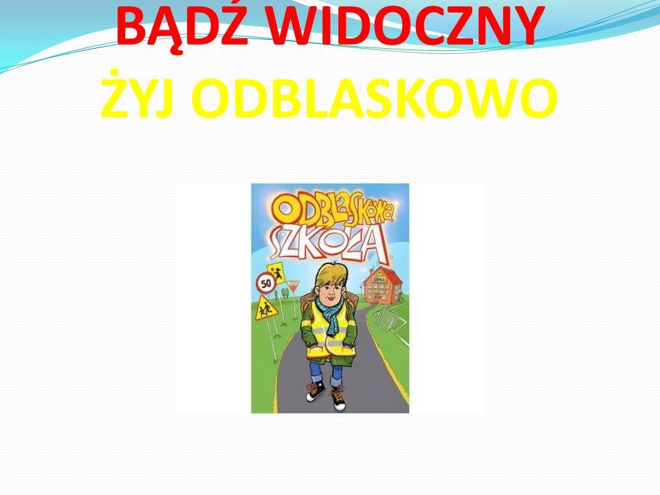 Dwukrotnie odwiedził naszą szkołę dzielnicowy z Niepołomic, który przekazał pierwszakom naklejki odblaskowe i kamizelki.