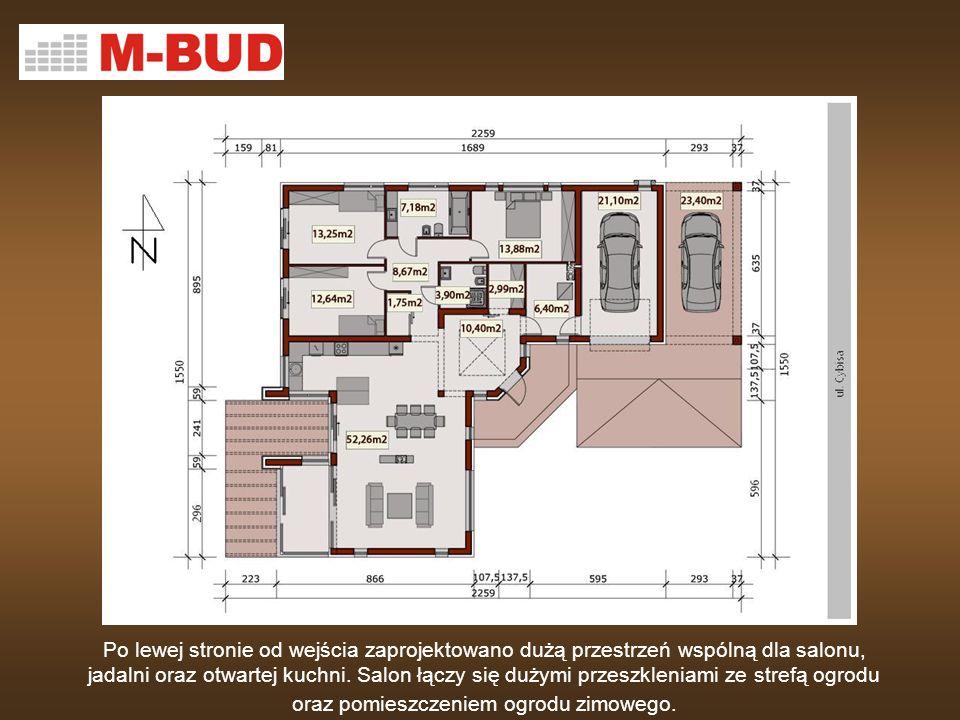 Po lewej stronie od wejścia zaprojektowano dużą przestrzeń wspólną dla salonu, jadalni oraz otwartej kuchni. Salon łączy się dużymi przeszkleniami ze