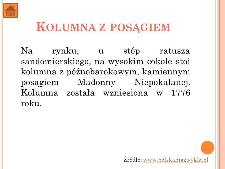 K OLUMNA Z POSĄGIEM Na rynku, u stóp ratusza sandomierskiego, na wysokim cokole stoi kolumna z późnobarokowym, kamiennym posągiem Madonny Niepokalanej