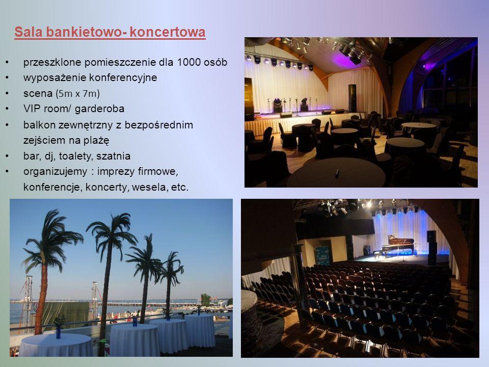 Sala bankietowo- koncertowa przeszklone pomieszczenie dla 1000 osób wyposażenie konferencyjne scena (5m x 7m) VIP room/ garderoba balkon zewnętrzny z bezpośrednim zejściem na plażę bar, dj, toalety, szatnia organizujemy : imprezy firmowe, konferencje, koncerty, wesela, etc.