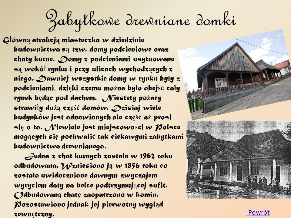 Zabytkowe drewniane domki G ł ówn ą atrakcj ą miasteczka w dziedzinie budownictwa s ą tzw. domy podcieniowe oraz chaty kurne. Domy z podcieniami usytu