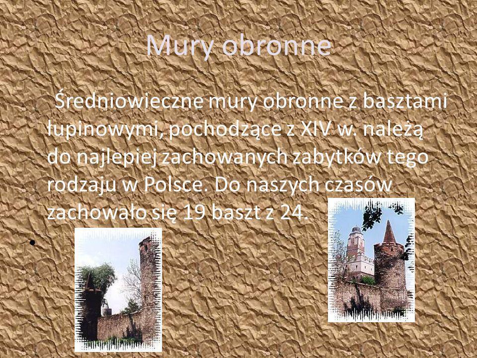 Mury obronne Średniowieczne mury obronne z basztami łupinowymi, pochodzące z XIV w. należą do najlepiej zachowanych zabytków tego rodzaju w Polsce. Do
