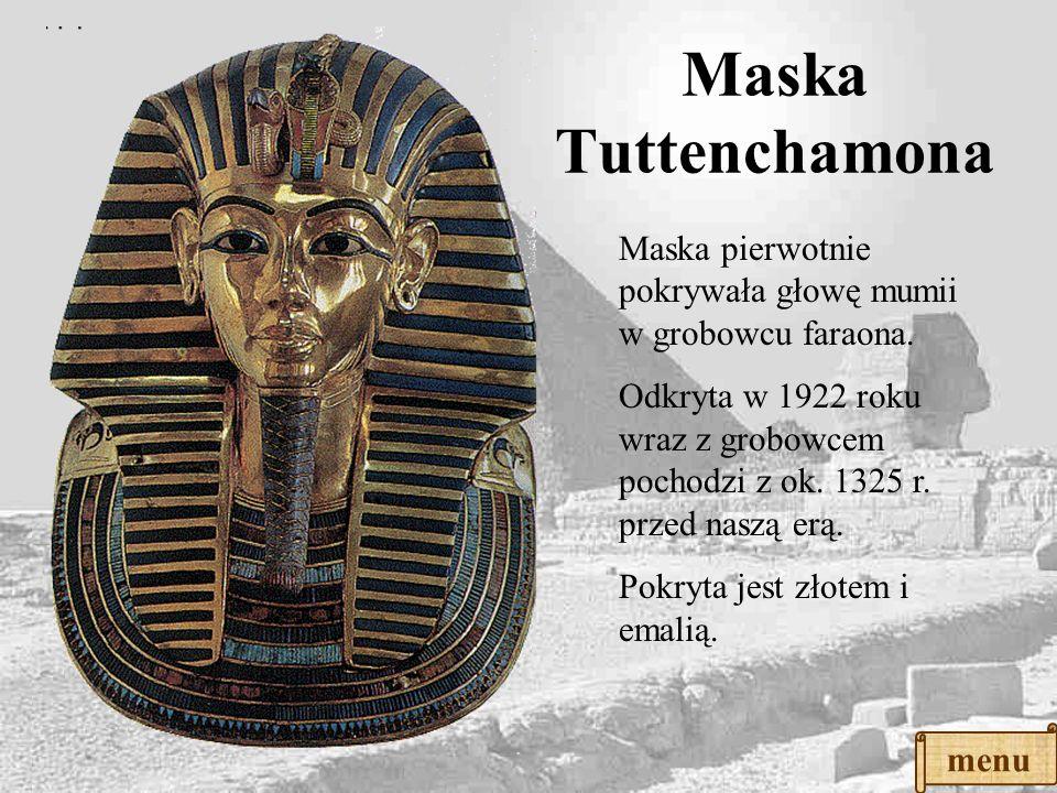 Bogini Hathor przedstawiona z dyskiem słonecznym na głowie i rogami krowimi. Typowy układ postaci: głowa z boku, oko i ramiona z przodu. Rzeźba – płas