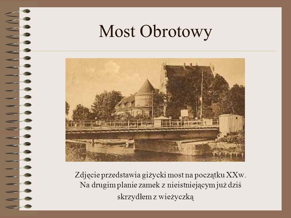 Most Obrotowy Zdjęcie przedstawia giżycki most na początku XXw. Na drugim planie zamek z nieistniejącym już dziś skrzydłem z wieżyczką