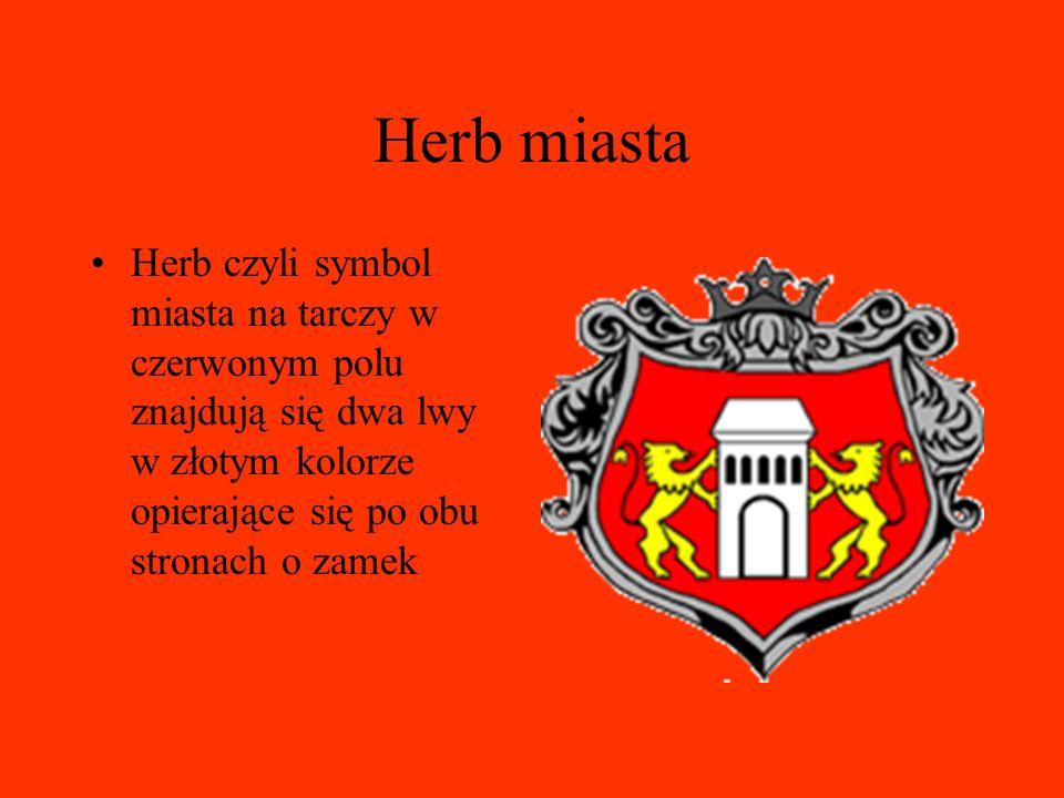 Herb miasta Herb czyli symbol miasta na tarczy w czerwonym polu znajdują się dwa lwy w złotym kolorze opierające się po obu stronach o zamek