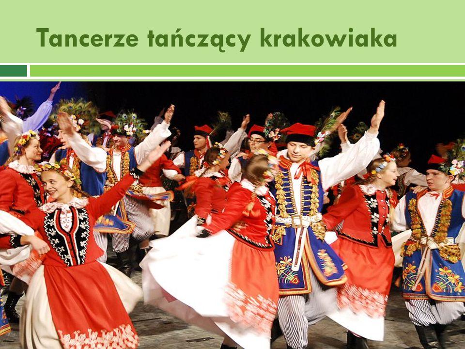 Tancerze tańczący krakowiaka