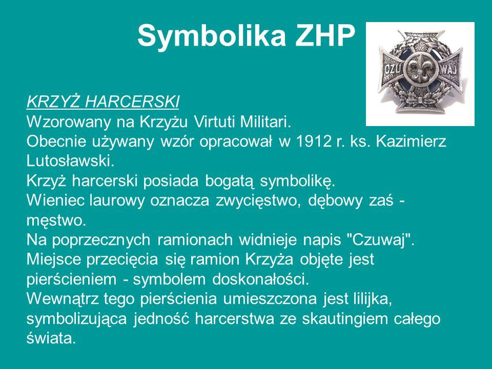 Symbolika ZHP KRZYŻ HARCERSKI Wzorowany na Krzyżu Virtuti Militari. Obecnie używany wzór opracował w 1912 r. ks. Kazimierz Lutosławski. Krzyż harcersk