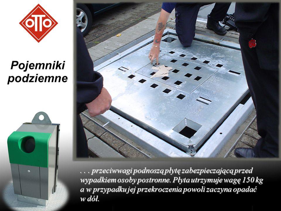 ... przeciwwagi podnoszą płytę zabezpieczającą przed wypadkiem osoby postronne. Płyta utrzymuje wagę 150 kg a w przypadku jej przekroczenia powoli zac