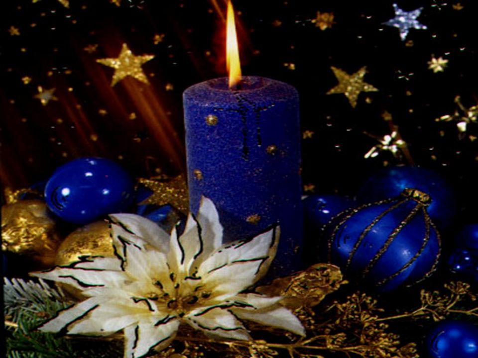 Zrodzony na sianie, w półmroku stajenki, Śpi w ramionach Marii Jezus malusieńki Świętą noc złocista gwiazda opromienia Gromadzą się wokół przyjazne st