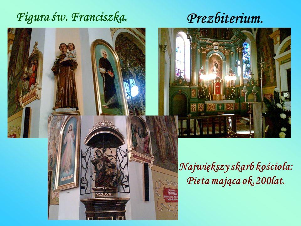 Ołtarz św. Antoniego (lewa nawa). Polichromia na końcu lewej nawy.Ukrzyżowanie Chrystusa. Piękna, drewniana ambona.