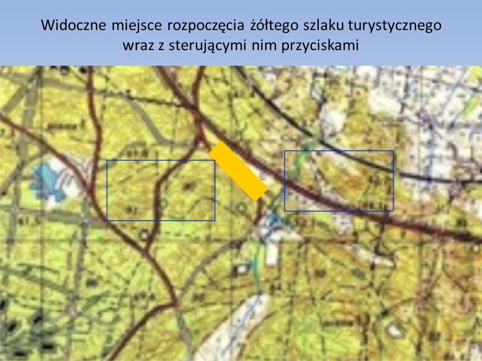 Widoczne miejsce rozpoczęcia żółtego szlaku turystycznego wraz z sterującymi nim przyciskami