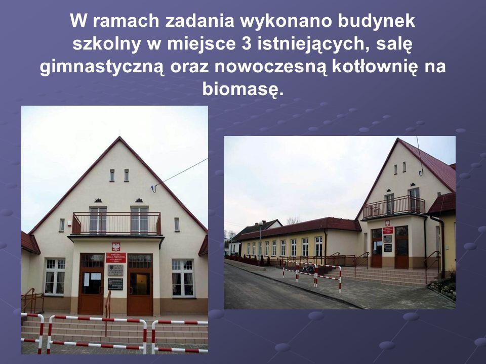 W ramach zadania wykonano budynek szkolny w miejsce 3 istniejących, salę gimnastyczną oraz nowoczesną kotłownię na biomasę.