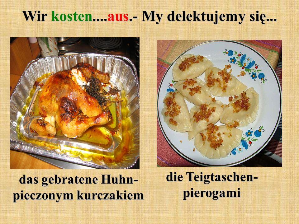 Wir kosten....aus.- My delektujemy się... das gebratene Huhn- pieczonym kurczakiem die Teigtaschen- pierogami