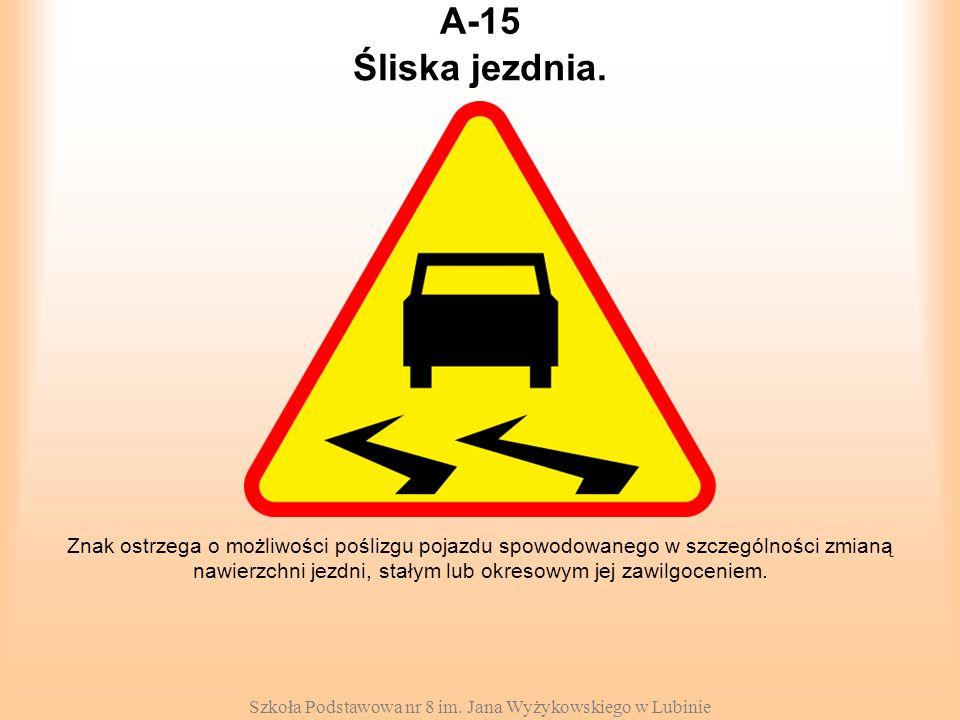 Szkoła Podstawowa nr 8 im. Jana Wyżykowskiego w Lubinie A-15 Znak ostrzega o możliwości poślizgu pojazdu spowodowanego w szczególności zmianą nawierzc