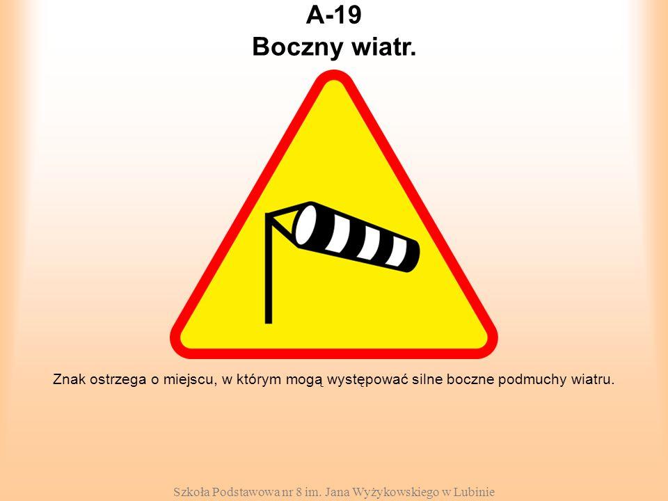 Szkoła Podstawowa nr 8 im. Jana Wyżykowskiego w Lubinie A-19 Znak ostrzega o miejscu, w którym mogą występować silne boczne podmuchy wiatru. Boczny wi