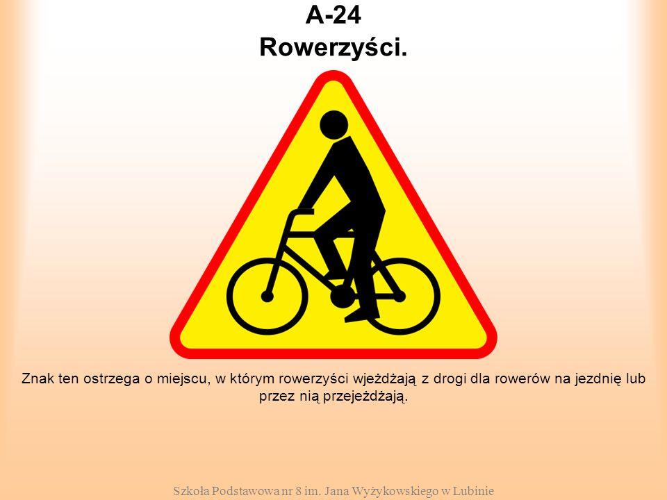 Szkoła Podstawowa nr 8 im. Jana Wyżykowskiego w Lubinie A-24 Znak ten ostrzega o miejscu, w którym rowerzyści wjeżdżają z drogi dla rowerów na jezdnię